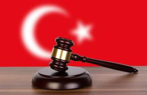 Wooden gavel and flag of Turkey