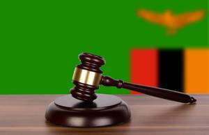 Wooden gavel and flag of Zambia