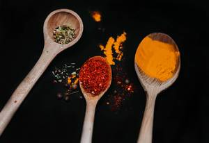 Wooden Spoons With Colorful Spices