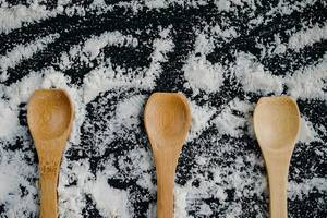 Wooden spoons with white flour