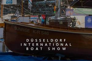"Wooden steam boat Surnise K-R 546, exhibited at a fair in Germany, next to the title ""Düsseldorf International Boat Show"""
