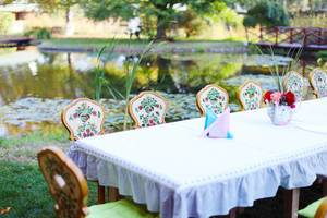 Wooden table and chairs ready for party, by the lake (Flip 2019)
