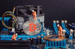 Workers mining Bitcoins