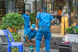 Workers working on Power Lines in Bookstreet in Ho Chi Minh City