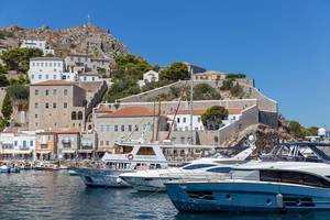 Yachts and ferries in the port of the saronic and car-free island Hydra in Greece