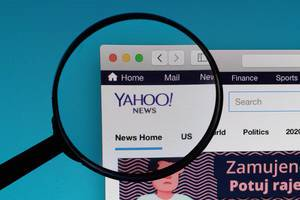 Yahoo! News logo under magnifying glass