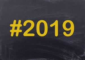 Year #2019 written on a black chalk board as hashtag