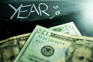 YEAR 2020 with dollar bills