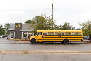 Yellow Bus parked at McDonald