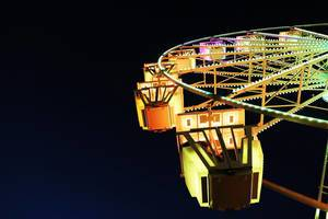 Yellow Ferris wheel, close-up view