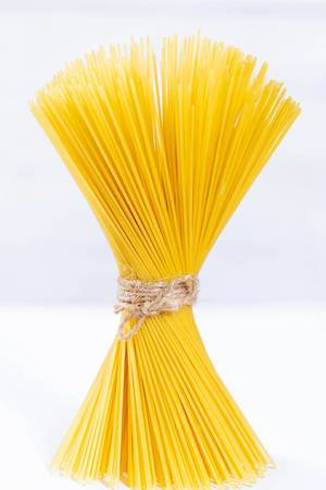 Yellow raw spaghetti
