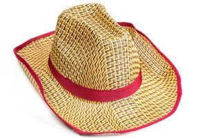Yellow wicker straw hat on white background