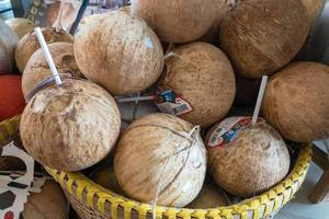 Young coconuts with drinking straws at Danilovsky Market in Moscow