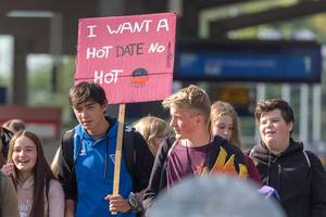 "Young generation of Fridays-for-Future movement demonstrates at global climate strike ""I want a hot date - no hot planet"""