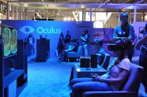 Young girls plays VR games with Oculus Rift and blue lighting