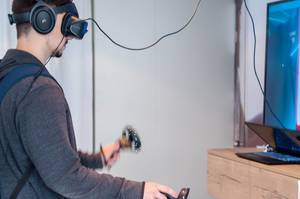 Young man using a Windows Mixed Reality headset
