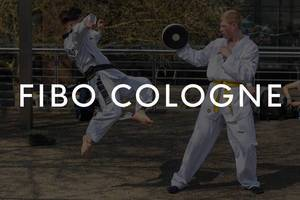 """Young martial artists training on an outdoor area, with the picture title """"Fibo Cologne"""""""