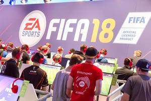 Young men at German games fair at a interactive gaming preview for Fifa18 by EA