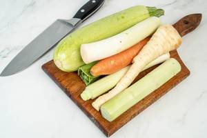 Zucchini Carrot and Parsnip on the wooden cutting board