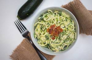 Zucchini pasta in a white bowl top view